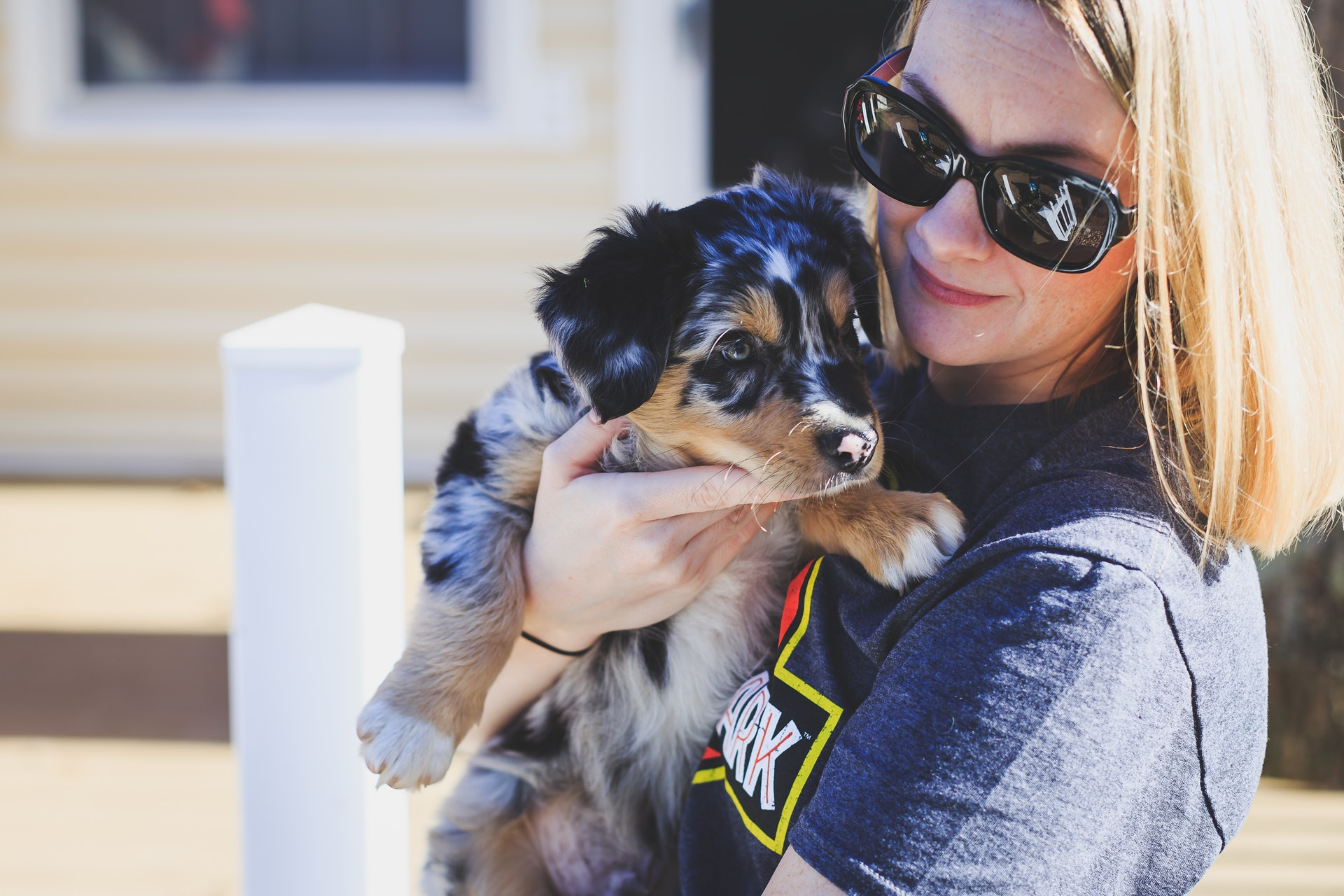 Woman holding a dog, showing how to bond with a new rescue dog